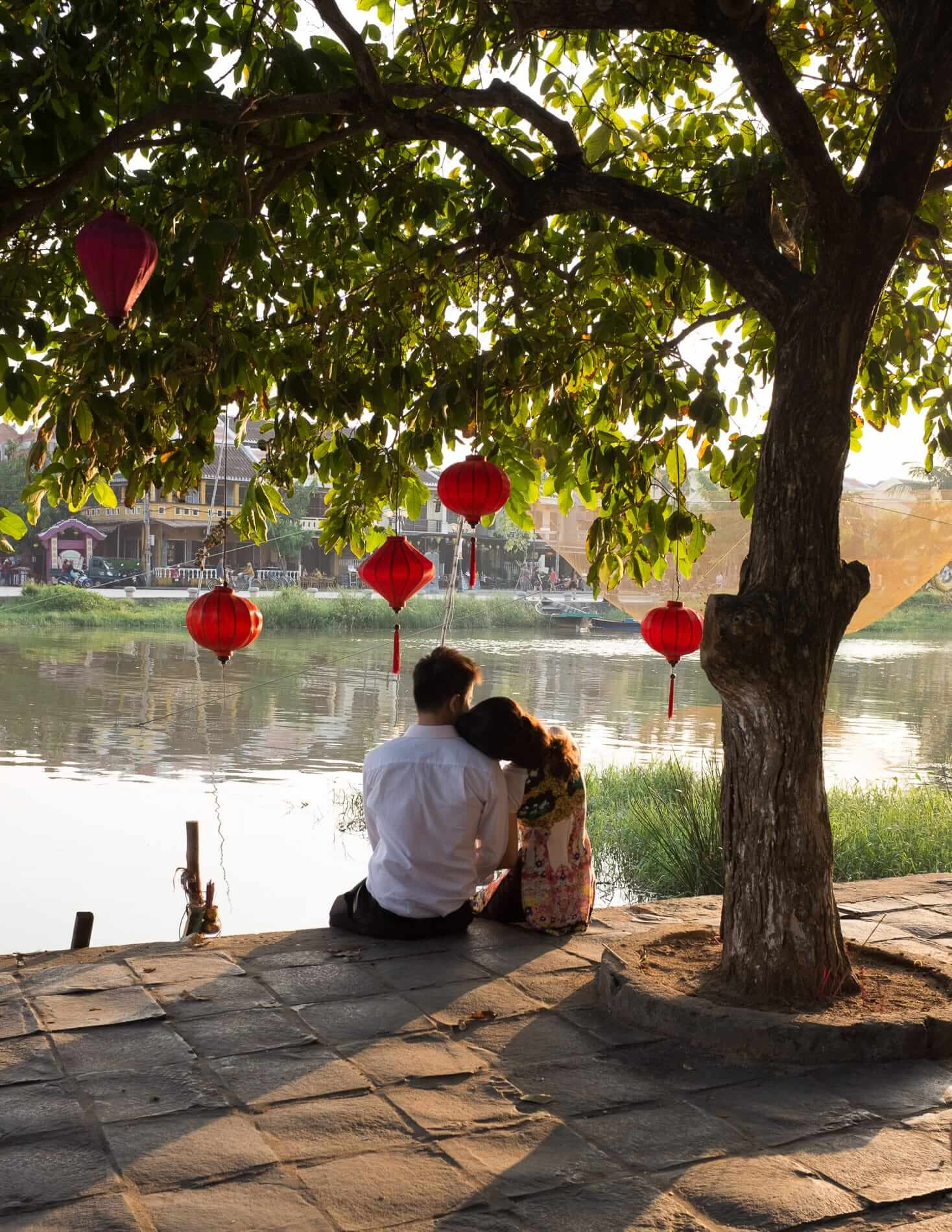 A couple spend the day under a tree