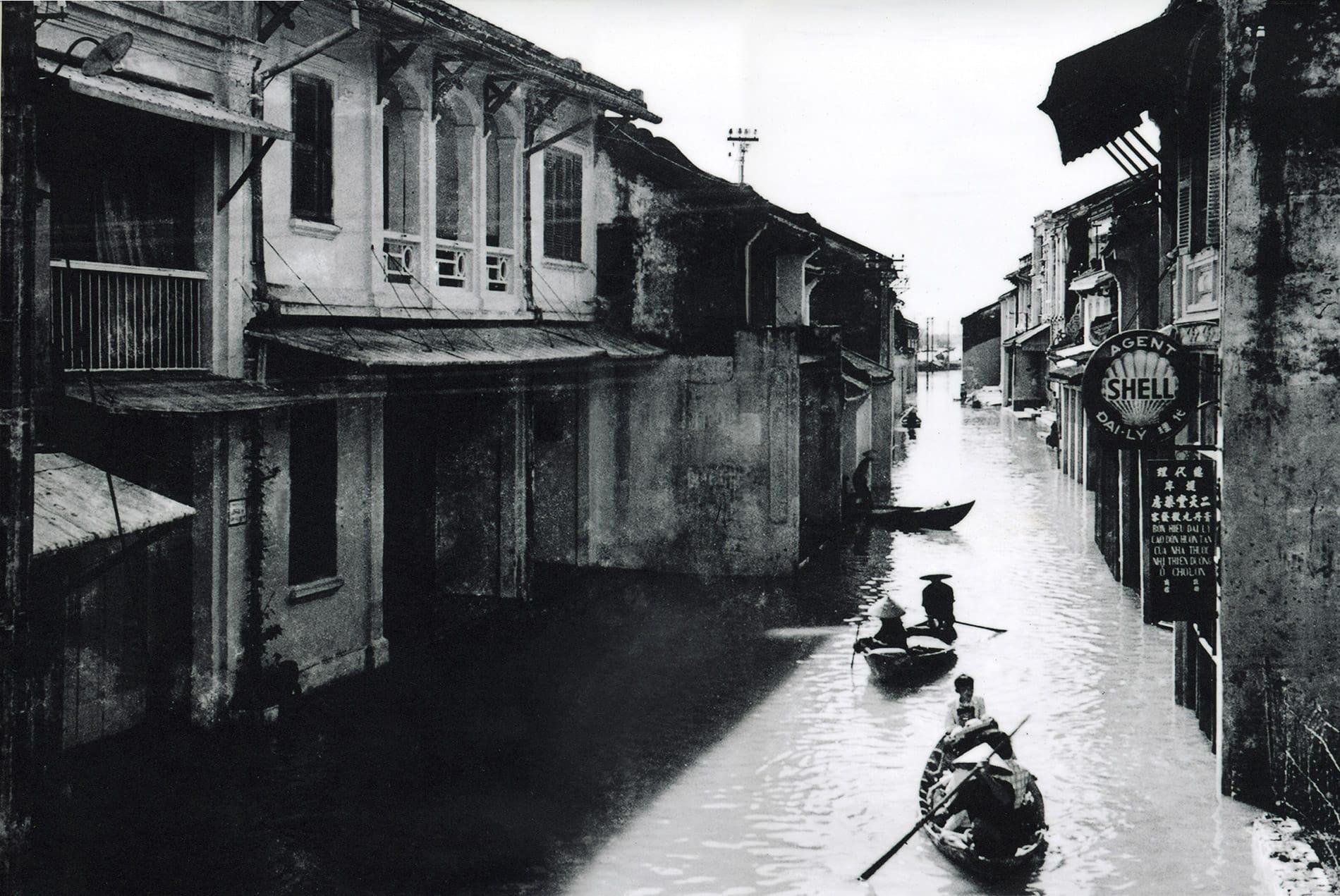 an old photo of Hoi An during a major flood