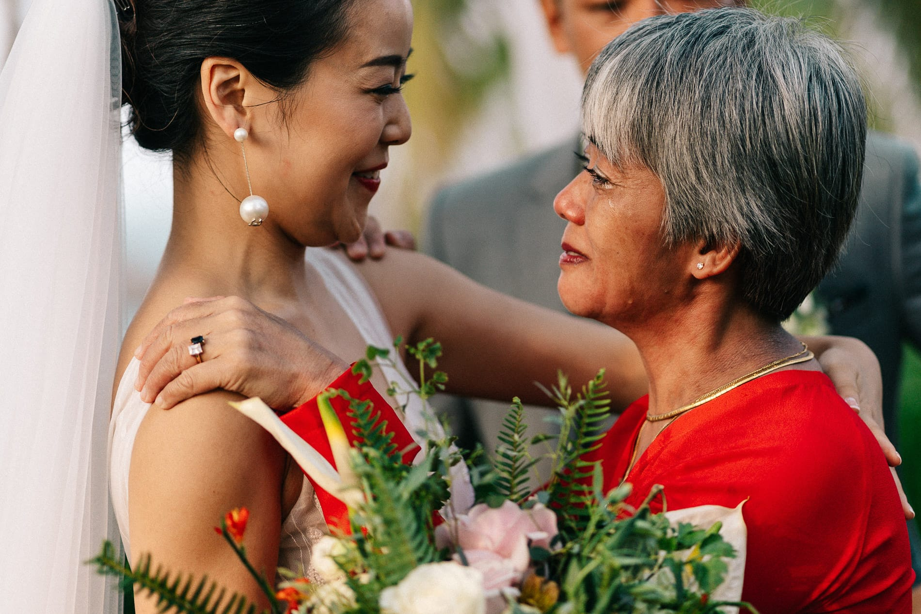 A mother's emotional moment during a wedding in Hoi An