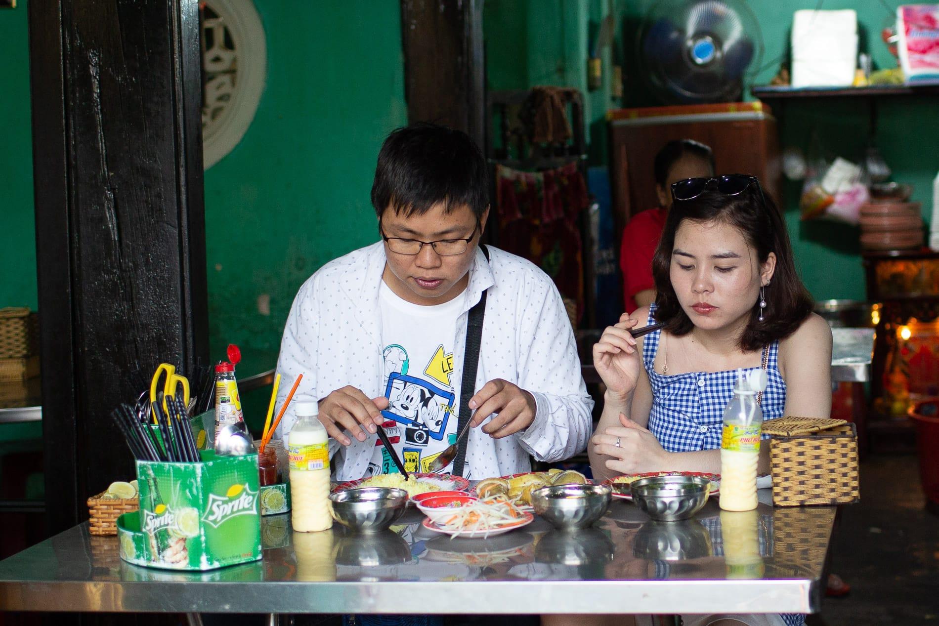 A couple eating at Com Ga Ba Buoi