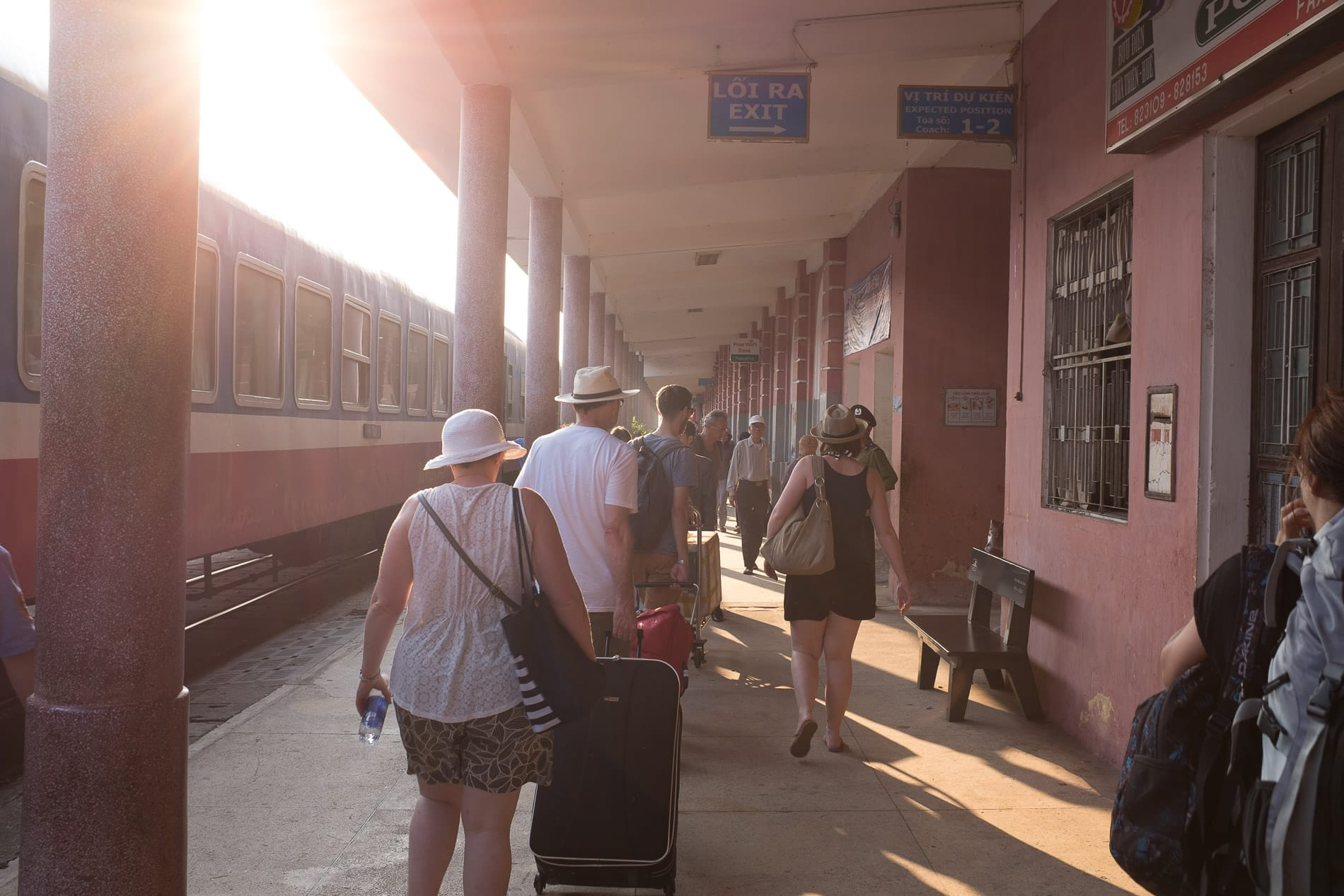 travelers pack the train station