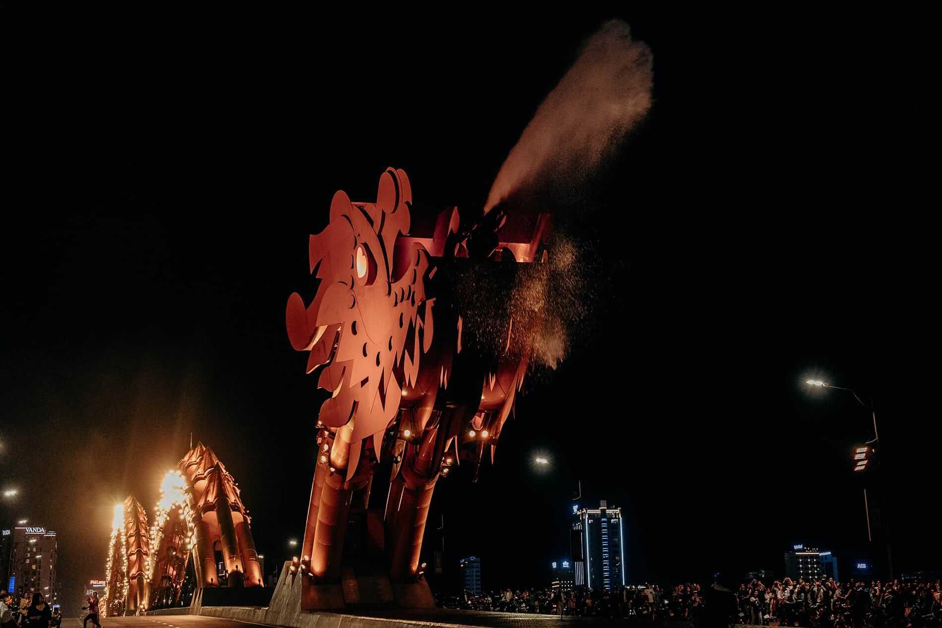 The Dragon Bridge erupts water at night