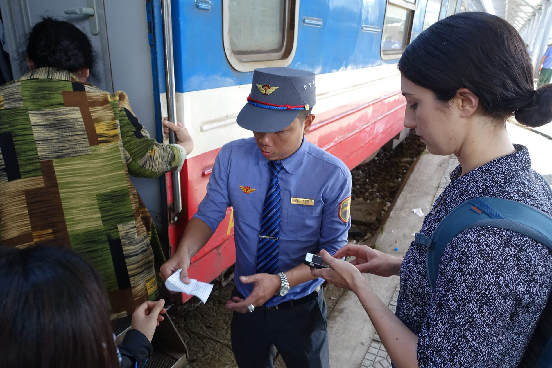 ticket inspector check tickets before boarding